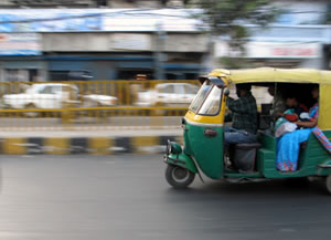 Picture of a fast-moving rickshaw.